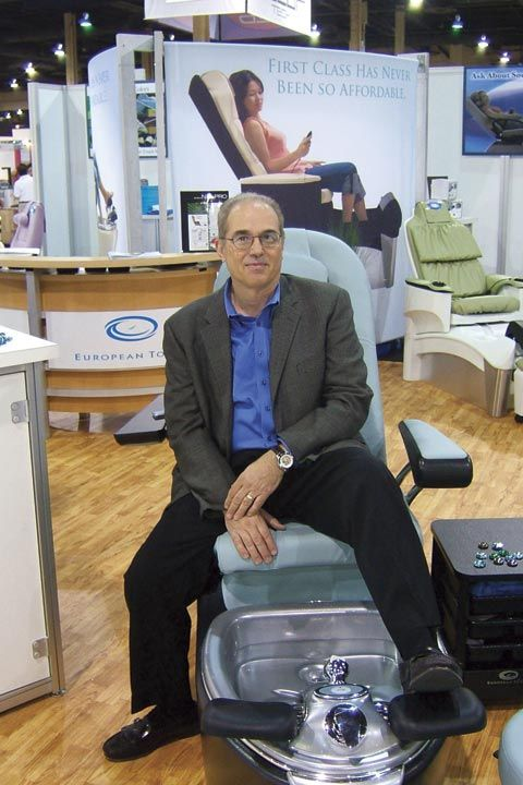 <p>European Touch&rsquo;s CEO, Joe Veltri, posed atop the Rinato Spa Chair, which features the company&rsquo;s new Clean Touch Pipe-Free technology.</p>