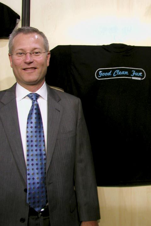 <p>Barbicide president Alan Murphy poses by one of his company&rsquo;s cute new promotional T&rsquo;s.</p>