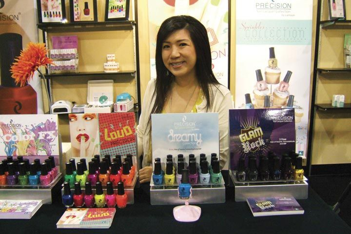 <p>Precision&rsquo;s Sophia Tran poses behind the company&rsquo;s new Dreamy polish collection. Lamoon comes out with new seasonal shades throughout the year, with fun collections like Color FX, Get Loud, and Glam Rock.</p>