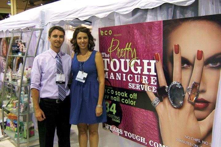 <p>NAILS associate editor Tim Crowley poses with Star Nail&rsquo;s Arica Carpenter, who was excited to show off the company&rsquo;s new Eco Pretty Tough Manicure soak-off gels.</p>