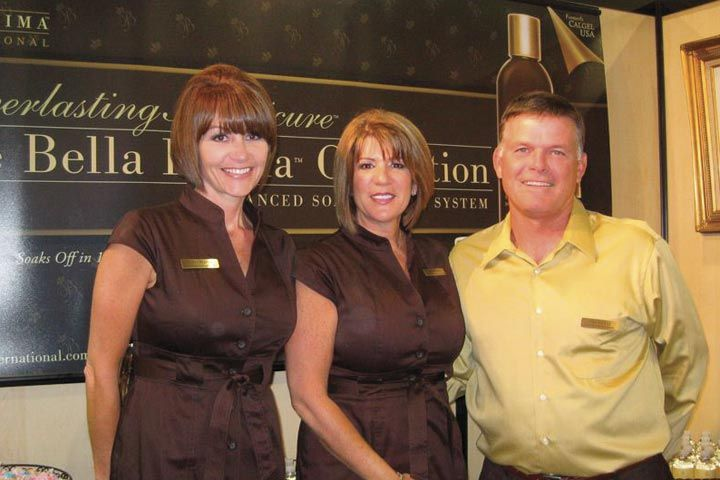 <p>Bellissima International&rsquo;s Debra Martin, Marnie Hadley, and John Hadley enhanced their company&rsquo;s branding by donning matching show outfits and handing out customized M&amp;Ms.</p>