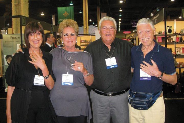 <p>Roberta Rondo, Gloria Abraskin, Al Abraskin, and Gianluigi Cappi pose for a photo at the It&rsquo;s So Easy booth.</p>