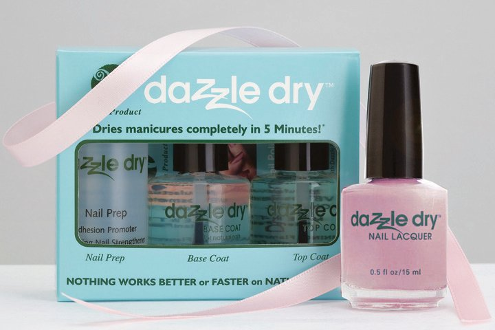 """<p>The <a href=""""http://vbcosmetics.com"""">Dazzle Dry</a> three-piece vegan quick-dry nail polish system kit includes a Nail Prep, Dazzle Dry base coat, and Dazzle Dry top coat. It is accompanied by the Soft Caress pink shade of Dazzle Dry Nail Polish. During the month of October, 20% of the proceeds will benefit the Susan G. Komen Foundation. Soft Caress polish can also be purchased separately and a donation will be made.</p>"""