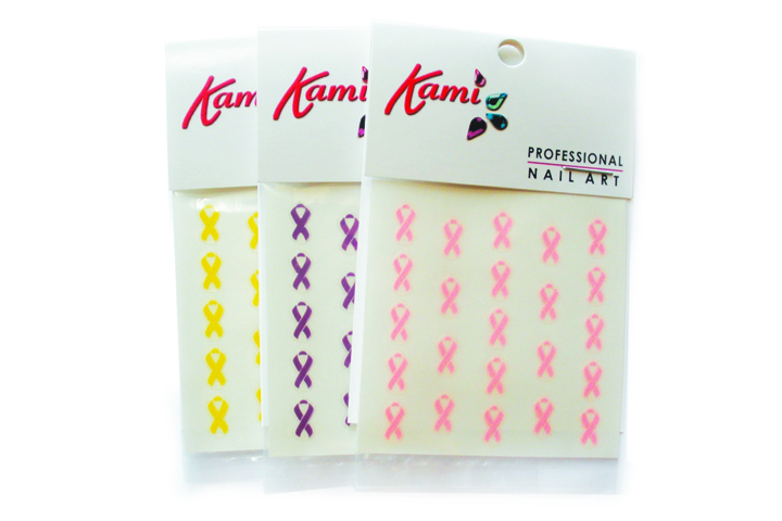 """<p>From<a href=""""http://www.innovative-beauty.com/kami.php""""> Innovative Beauty Design</a>, Kami Nail Arts&rsquo; Awareness Ribbon Nail Art Decals donates 25% of its proceeds from sales of any of the three decals to different causes. The pink decals go to the National Breast Cancer Foundation, while the purple goes toward Alzheimer&rsquo;s and cancer awareness, and the yellow decals for supporting the troops. Each sheet has 23 pre-adhesive nail art decals.</p>"""