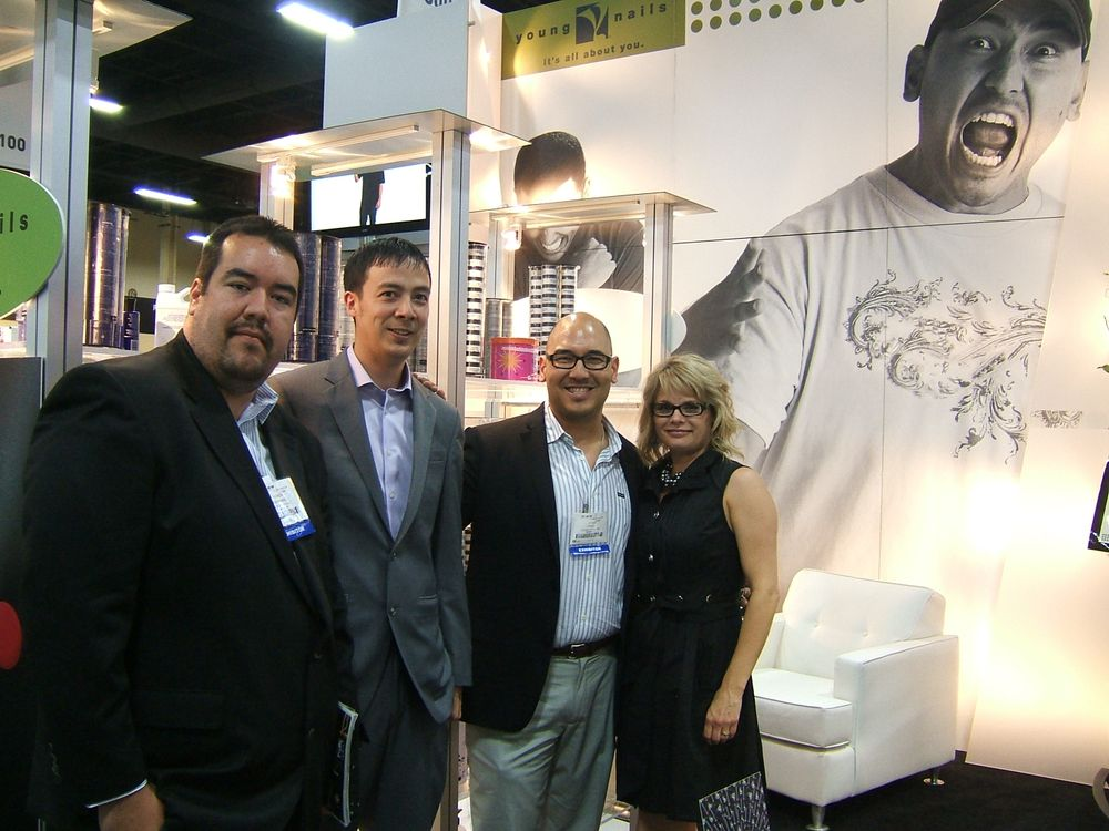 <p>This was the first year Young Nails had a booth at Cosmoprof. Ramon Hernandez, Tom Huynh, Greg Salo, and Tracey Reierson were quite happy with the outcome of their meetings.</p>