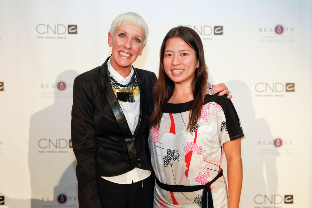 <p>CND co-founder Jan Arnold poses for a photo with VietSALON associate editor Kim Pham where Arnold unveiled a new Beauty Changes Lives scholarship honoring actress Tippi Hedren.</p>