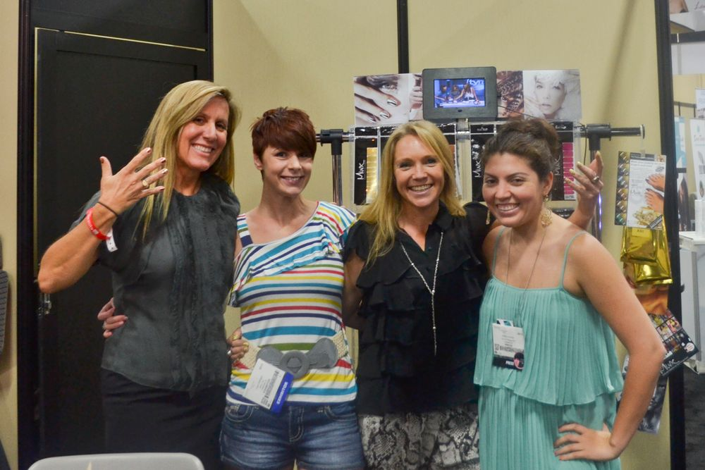 "<p class=""normal"">Minxes Janice Jordan (far left) and Dawn Lynch-Goodwin (second to right) show off their nails alongside Cosmopolitan nail tech Lisa Delegge (second from left) and NAILS senior editor Beth Livesay (far right).</p>"