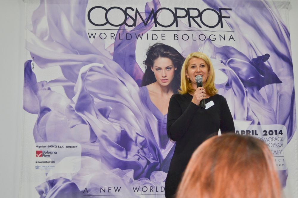 "<p class=""normal"">Daniela Ciocan, marketing director of Cosmoprof North America, addresses attendees at the PBA lunch.</p>"