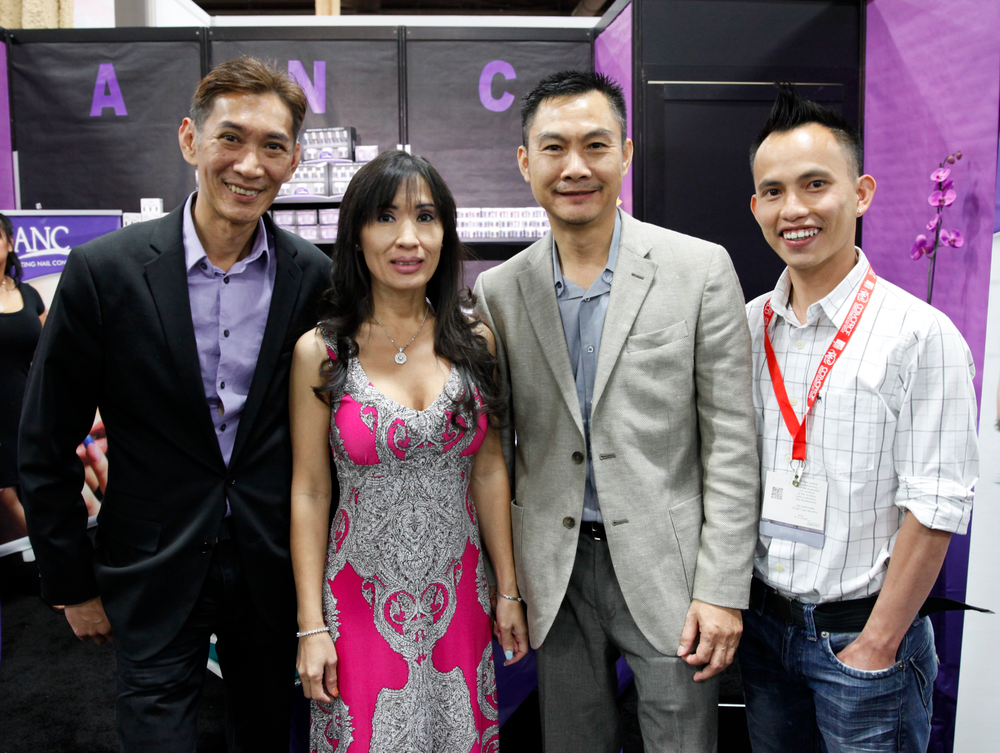 <p>Joseph Pham (left) and Hoang Duong (right) chatted with Amazing Nail Concepts&rsquo; Maya and Eric Huynh.</p>