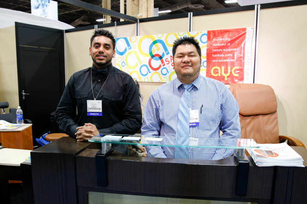 <p>AYC&rsquo;s VP of sales team Herald Masih and Huy Nguyen pose for a photo in front of the company&rsquo;s Berkley reception desk.</p>