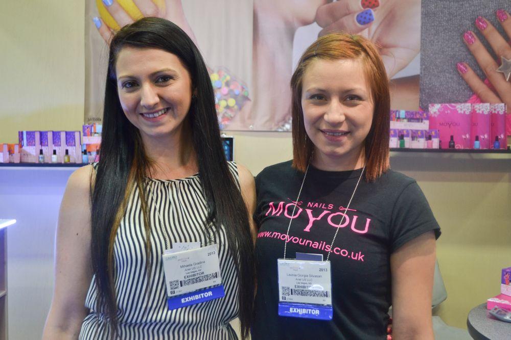 """<p class=""""normal"""">Mihaela Gradina and Lavinia Giorgiasilvason make nail stamping look fun at the MoYou booth.</p>"""