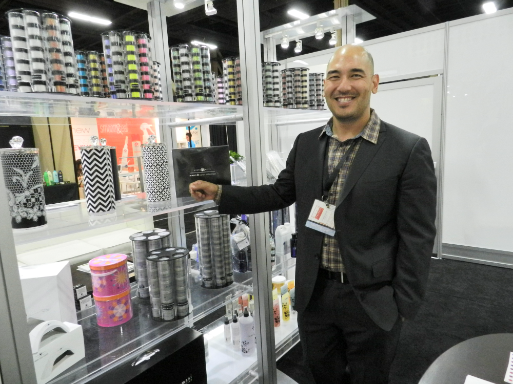 <p>Young Nails' Greg Salo grins his infectious smile at the company's booth.</p>