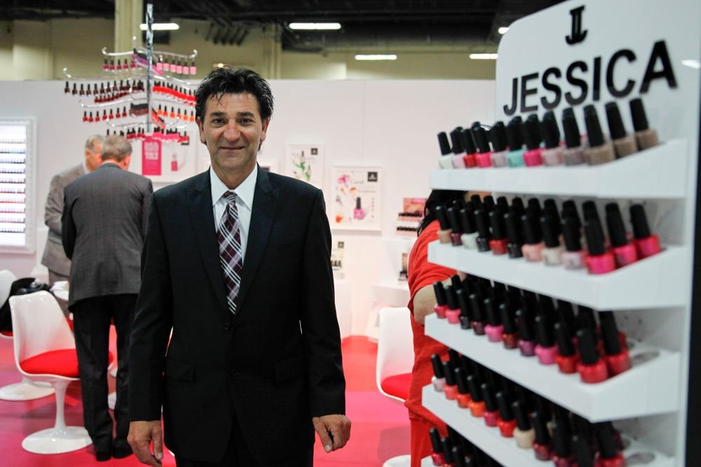 <p>Jessica Cosmetics&rsquo; Peter welcomed attendees to their booth.</p>