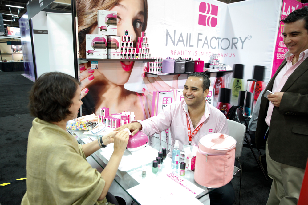 <p>Nail Factory&rsquo;s Adrian Loza helps Olga Lazarenko demo the company&rsquo;s gel-polish products. The nine-year-old Guadalajara-based company is entering the U.S. market for the first time.</p>