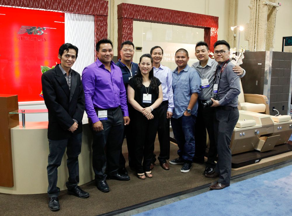 <p>The three-year-old company New Stars promoted its pedicure chairs for the first time at Cosmoprof. From left to right: Kevin Le, Michael Son, Thang Chau, Mei Ye, Quang Nguyen, Duc Nguyen, Kenny Vu, and Con Yap.</p>