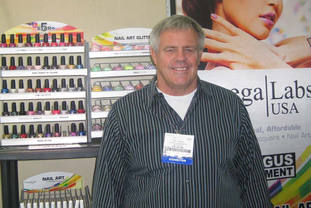<p>At the Robanda booth, Glen Hawkins shows off the new Omega Labs polish colors, which include mattes, metallics, and glitters.</p>
