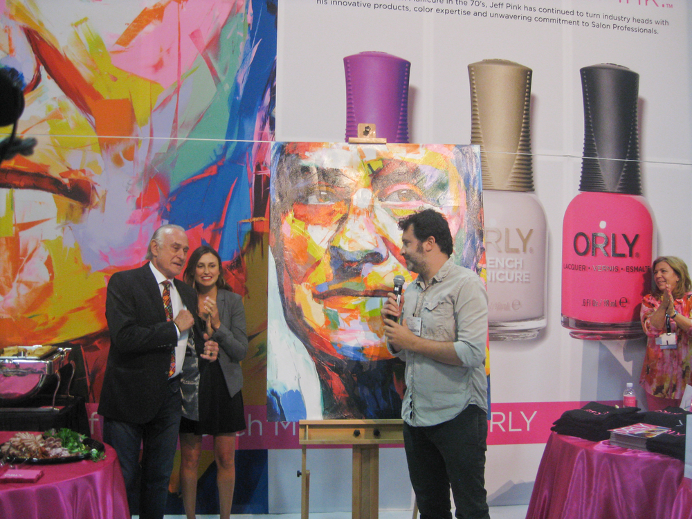 <p>&ldquo;It all started with Pink.&rdquo; &mdash; Jeff Pink, that is, pictured here (far left) with daughter Shanee and son Tal, as they unveil one facet of the company&rsquo;s new look, a sophisticated painting of Pink himself.</p>