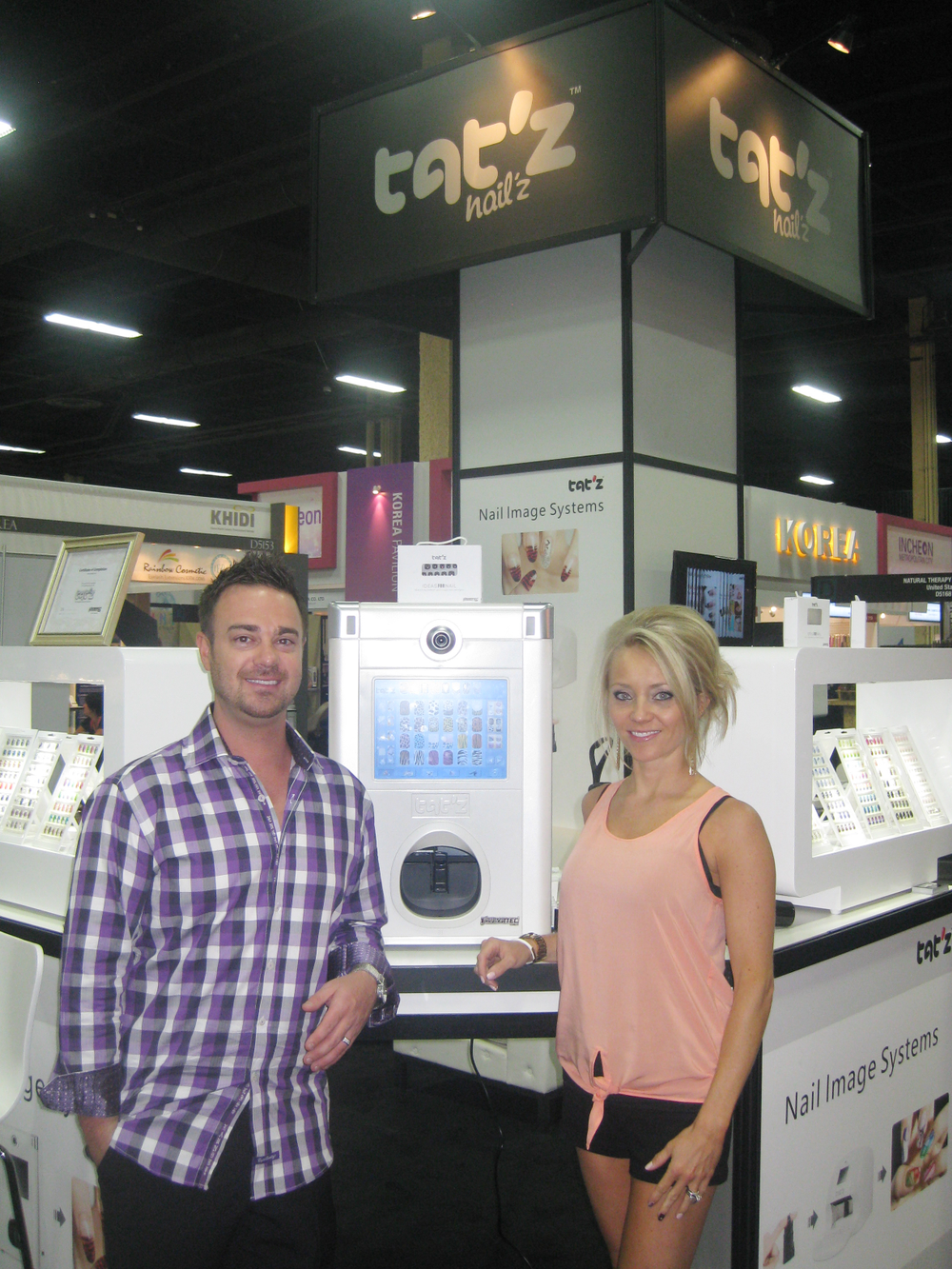 """<p class=""""normal"""">Brett and Jessica Boyer introduce Tat&rsquo;z Nail&rsquo;z nail art printer to salon owners and nail techs.</p>"""