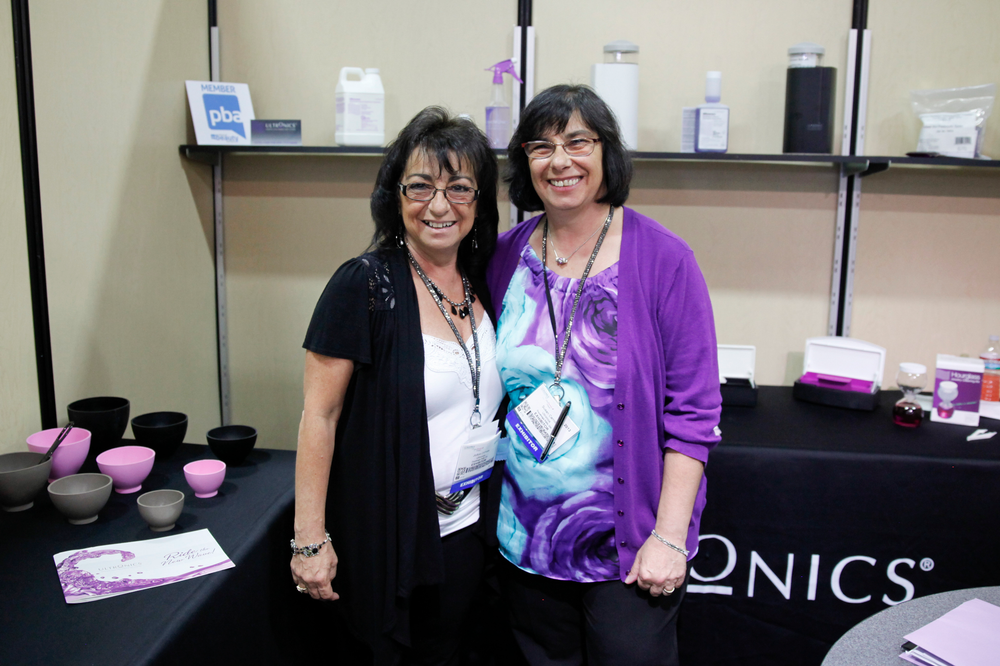 <p>Sisters JoAnn Diprete and Susan Carroll offered attendees the chance to sanitize their hands with Ultronics&rsquo; hand sanitizer.</p>