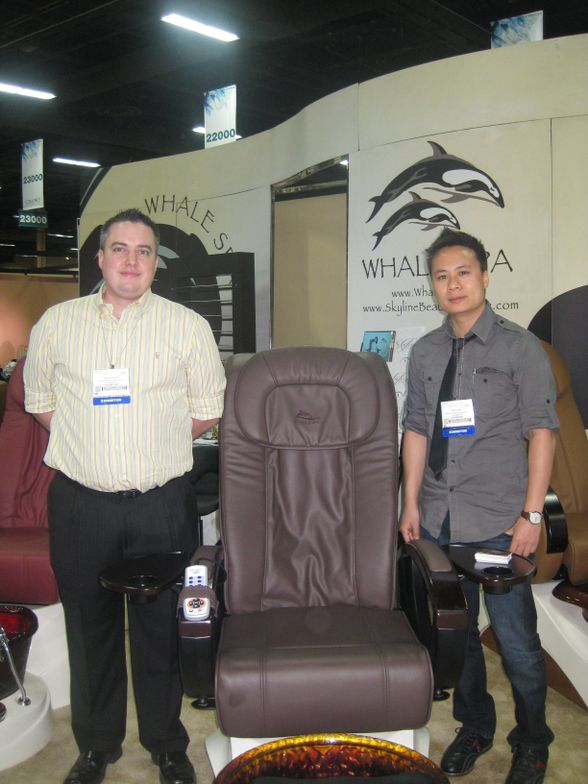 <p>James Adcock and Johnny Ngo stand by one of Whale Spa&rsquo;s new models, the Alden Crystal.</p>