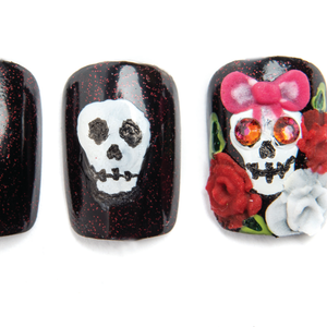 Use red and white acrylic to create roses, and pink acrylic to create a bow. Apply Swarovski...