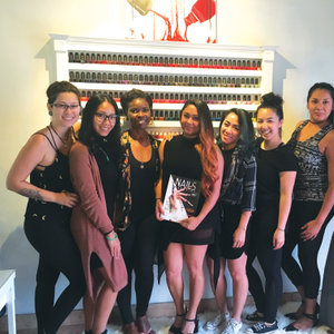 One of their clients brought in the June issue of NAILS, which the team posed with.