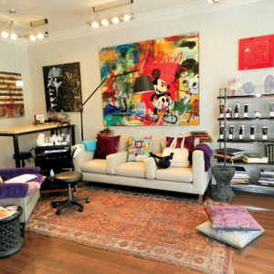 The salon features a faceto-face furniture arrangementtypically seen in living rooms.