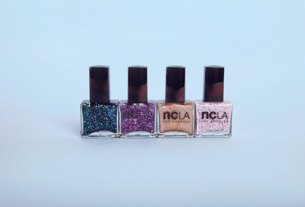 "<p>NCLA introduces the Black Market collection, consisting of four new lacquer shades: Prized Possessions, Bullion in a Bottle, Emerald Bay, and Cookies and Gold. These rich glitters are so rare people will do anything to get their hands on them. <a href=""http://www.shopncla.com/"">www.shopncla.com</a>. </p>"