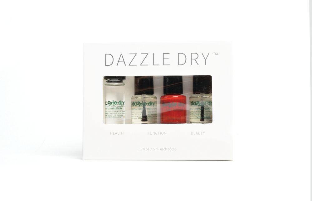 "<p>Dazzle Dry Holiday Mini Kits are ideal for green beauty gurus and luxury cosmetic lovers alike. Including a .25 fl. oz. Nail Prep and .167 fl. oz. each of Base Coat, Nail Lacquer, and Top Coat, the kits are both travel and retail friendly. Available in your choice of 36 shimmers and creams.<br /><a href=""http://www.dazzledry.com"">www.dazzledry.com</a></p>"