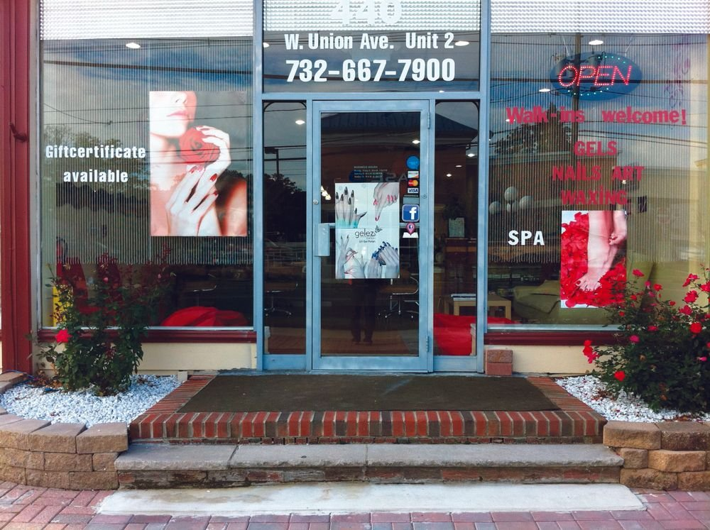 <p><strong>Glamor Nails, Bound Brook, N.J.</strong><br />&ldquo;We&rsquo;re about four months in since our grand opening. The current window display is a picture of a woman wearing red nail polish holding a rose. I purchased this picture for the purpose of making it the salon&rsquo;s signature image. To that end, the same picture is on the salon gift cards, coupons, and ads. The salon has a large storefront window, so in addition to that picture, I put a picture of red toenails with rose petals on the other side. I also have a beautiful Gelez gel-polish manicure poster on the front entrance door. I also want to add a sticker for LCN gel soon.&rdquo; &mdash; Chau &ldquo;Julie&rdquo; Le</p>
