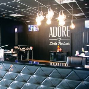 Adore's interior is dark, customized, and hygienic — differentiating it from all other salons in...