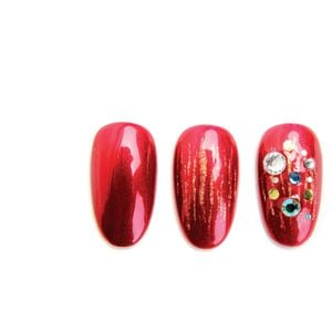 1. Apply a base coat and cure. Apply two coats of red gel-polish, curing between coats.