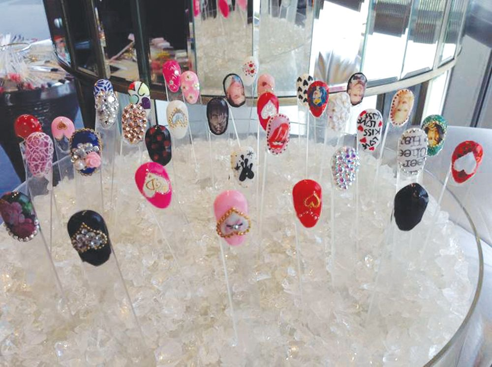 <p>We do sample nail art on plastic tips and put them in a vase right by our nail stations. This way our clients can peruse them, pull out ones they like and &ldquo;try them on&rdquo; to see what it would look like on their own nails. It also allows us to do special designs around a specific holiday or season and we can switch them out as often as necessary. In addition to these samples, we also have a booming Instagram page and our clients often come in with ideas of what they want from nails we&rsquo;ve done for other clients. We can all pull up Instagram on our phones or one of the iPads in the salon so clients can scroll through our pictures. <br />Cammy Nguyen, Blossom Beauty Lounge, Redondo Beach, Calif.</p>