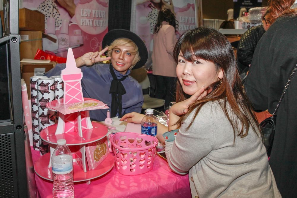 <p>Exclusive Nail Couture's Max Estrada demos his products on Meg Sawase</p>