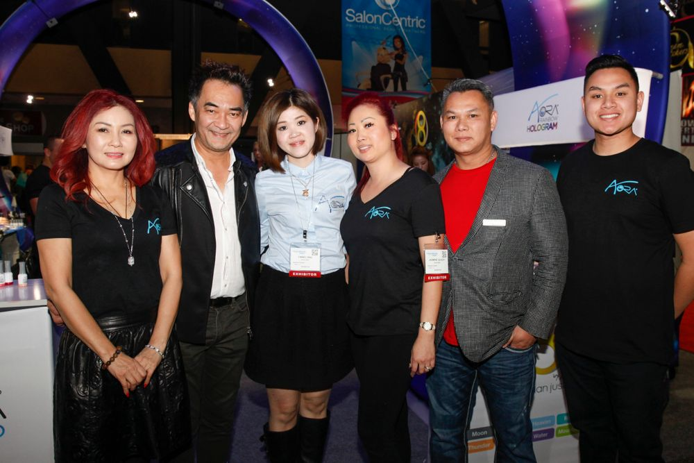 <p>Aora Nails's Vannie Luu, Trang Nguyen, Yinnie Ong, Jasmine Quach, Do Nguyen, and Alex Nguyen had an intergalactic presence with their newly expanded booth and products.</p>