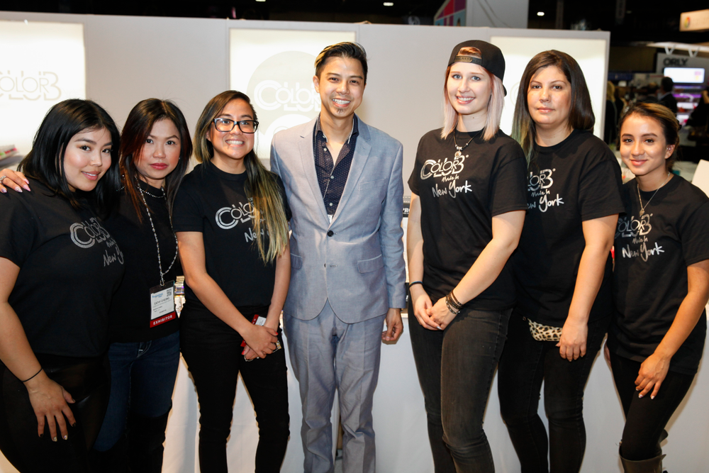 <p>Color Club's Robert Nguyen (center) with his team of nail artists.</p>