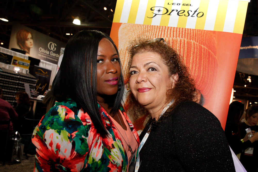 <p>Nail Labo artist Temeka Jackson with show attendee Elizabeth De Leon</p>