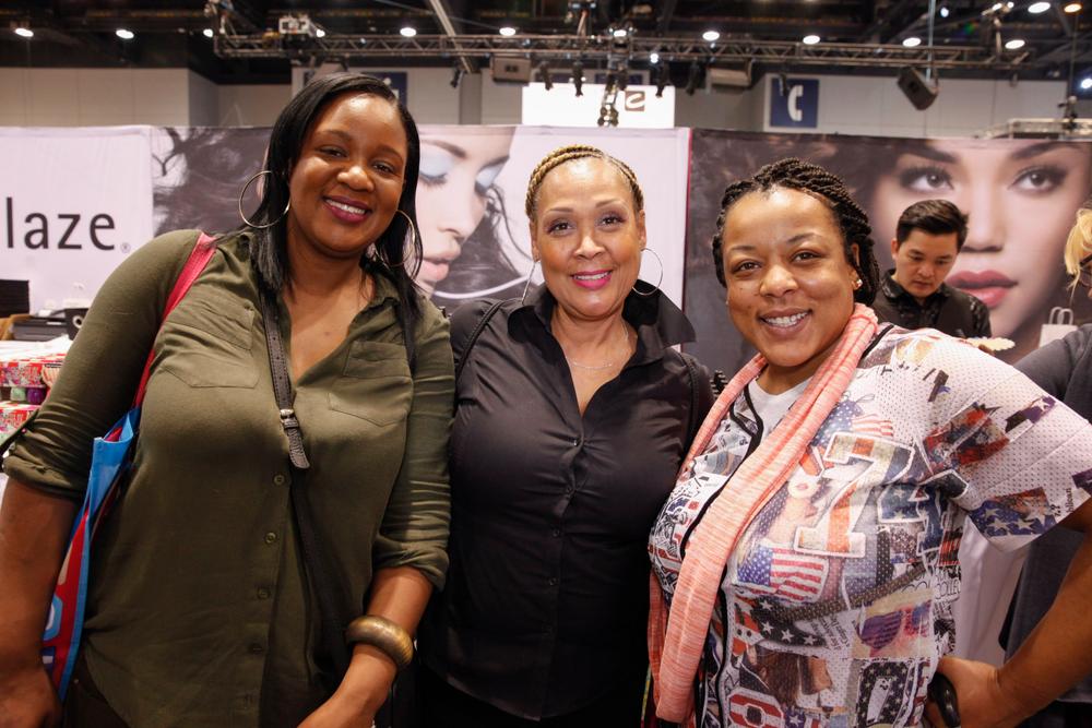 <p>AiiBeauty's Lynn Long (center) with Kristal Long and Paula Byrd</p>