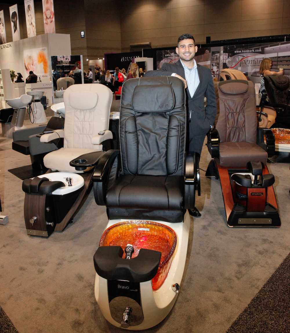 <p>Continuum brand manager Robert Rodriquez with his fleet of pedicure chairs — Continuum's Echo (left), Bravo (center) and Simplicity with built-in Belava heater/massager.</p>