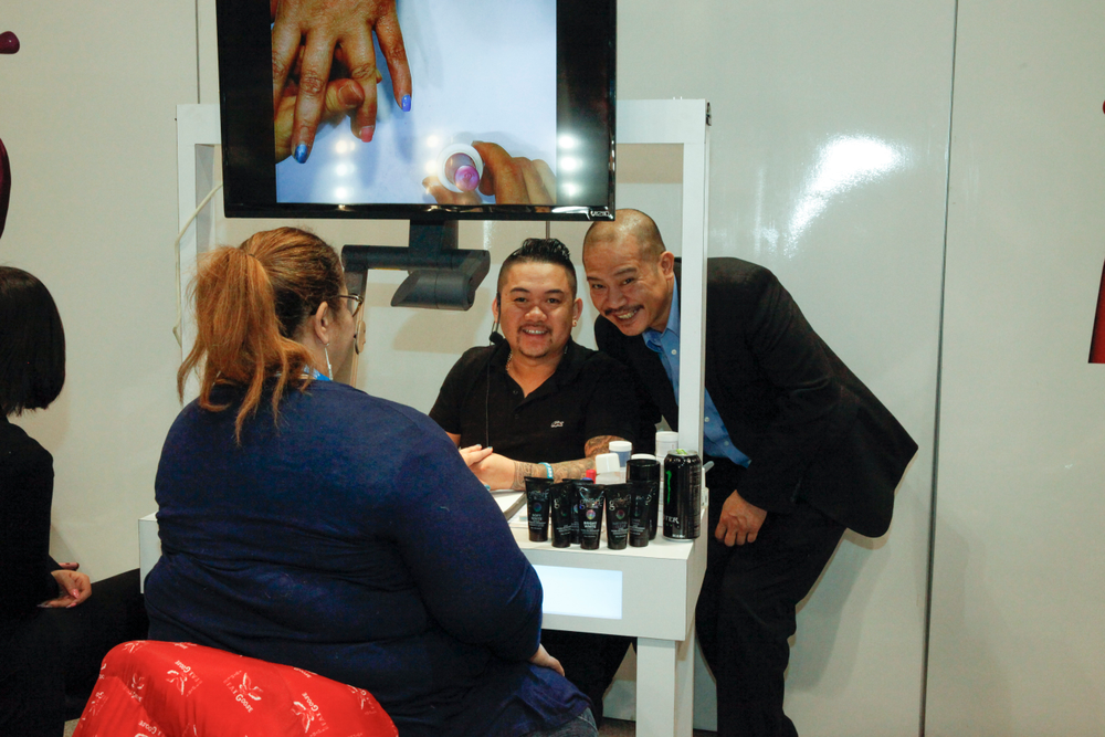 """<p>Gelish's Mikey Nguyen and Vu Nguyen demonstrates PolyGel. <a href=""""http://www.nailsmag.com/video/117922/how-to-use-gelish-polygel-natural-nail-overlay-and-reverse-french"""">Click here for a demo.</a></p>"""