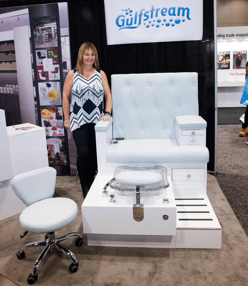 <p>Gulfstream's Suzanne Dixon, senior sales rep, showcases the Vienna Bench in a beautiful baby blue and that can seat up to seven clients.</p>
