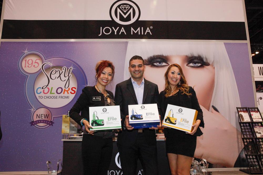 <p>Joya Mia's Sindy Mark, Benny Dadon, and educator Mami Griffin with Joya Mia's rechargeable and portable E-files.</p>