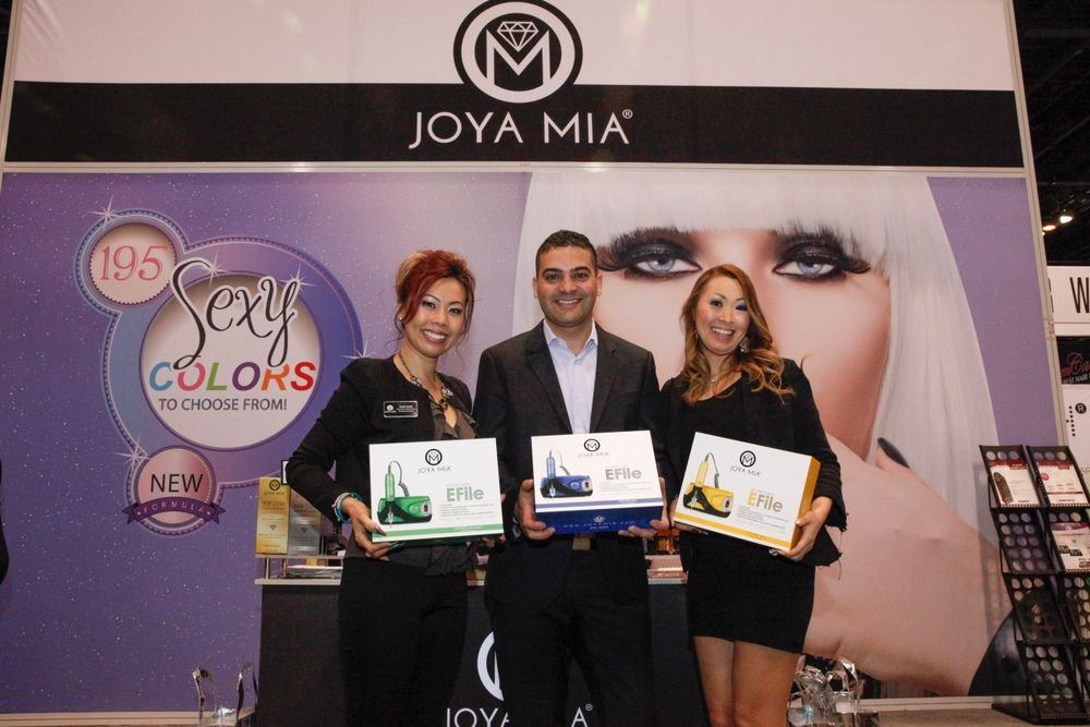 <p>Joya Mia's Sindy Mark, Benny Dadon, and educator Mami Griffin with Joya Mia's rechargeable and portable E-files.</p>