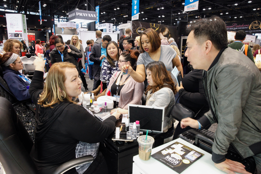 <p>Mindy Hardy shows nail art demos at the Whale Spa booth.</p>