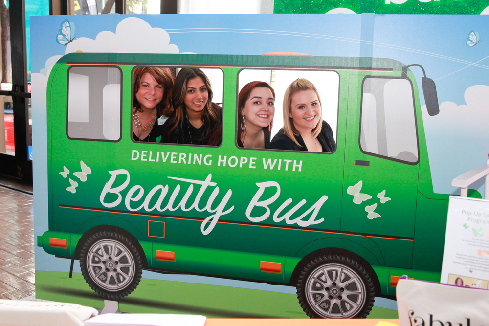 """<p>All aboard the Beauty Bus! Beauty Bus Foundation CEO Ronda Weeks, marketing associate Julie Hirji, volunteer nail tech Letrice Lopez (<a href=""""http://www.laspaonthego.com/"""">LA Spa On the Go</a>), and community outreach manager Amanda Batts had a fun photo op to raise awareness for the non-profit organization's mission to deliver beauty and grooming services to chronically ill men, women, and children. <a href=""""http://www.beautybus.org"""">www.beautybus.org</a></p>"""