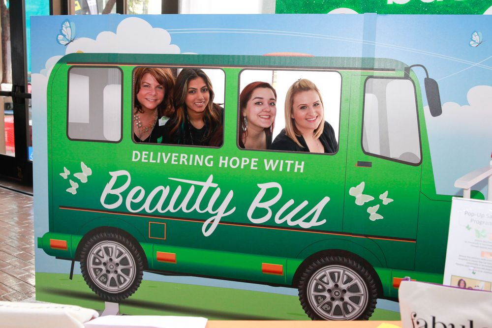 "<p>All aboard the Beauty Bus! Beauty Bus Foundation CEO Ronda Weeks, marketing associate Julie Hirji, volunteer nail tech Letrice Lopez (<a href=""http://www.laspaonthego.com/"">LA Spa On the Go</a>), and community outreach manager Amanda Batts had a fun photo op to raise awareness for the non-profit organization's mission to deliver beauty and grooming services to chronically ill men, women, and children. <a href=""http://www.beautybus.org"">www.beautybus.org</a></p>"