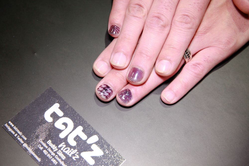<p>Buddy Sims shows his nail designs using the Tat'z Nailz nail art machine.</p>
