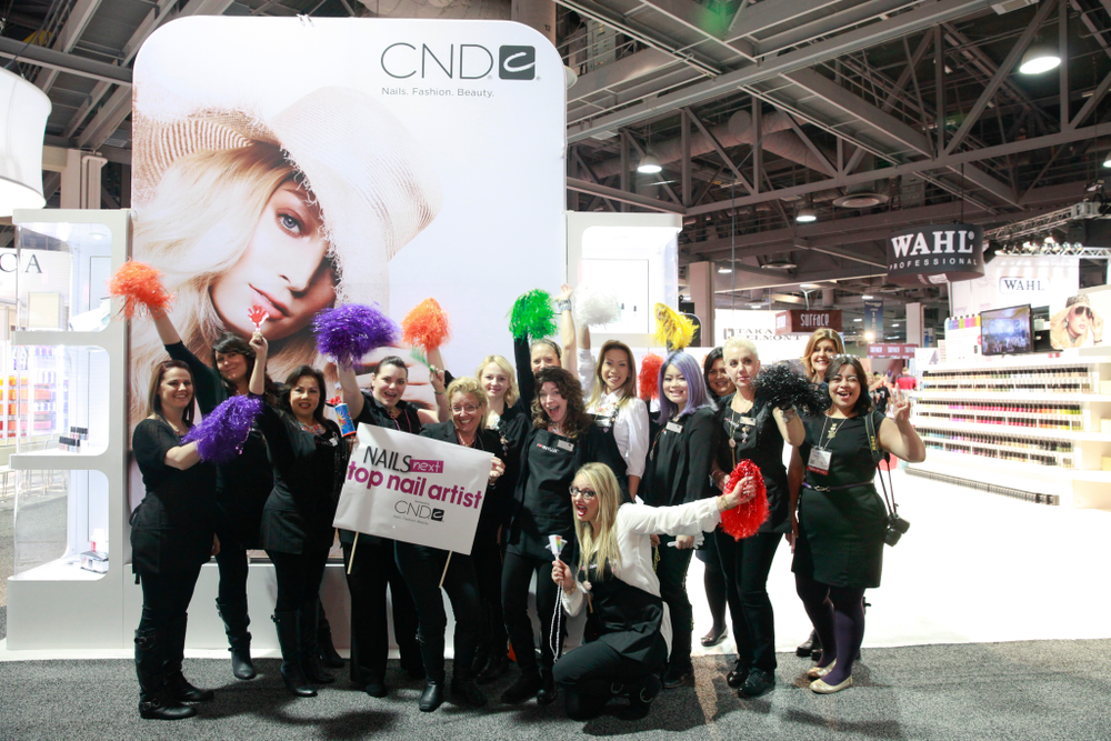 <p>NAILS Next Top Nail Artist premiere sponsor team CND erupt in cheers upon seeing the NTNA Top 3 at the entrance.</p>