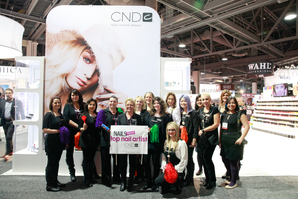 <p>NAILS Next Top Nail Artist premiere sponsor team CND waits patiently to greet the NTNA Top 3 contestants.</p>