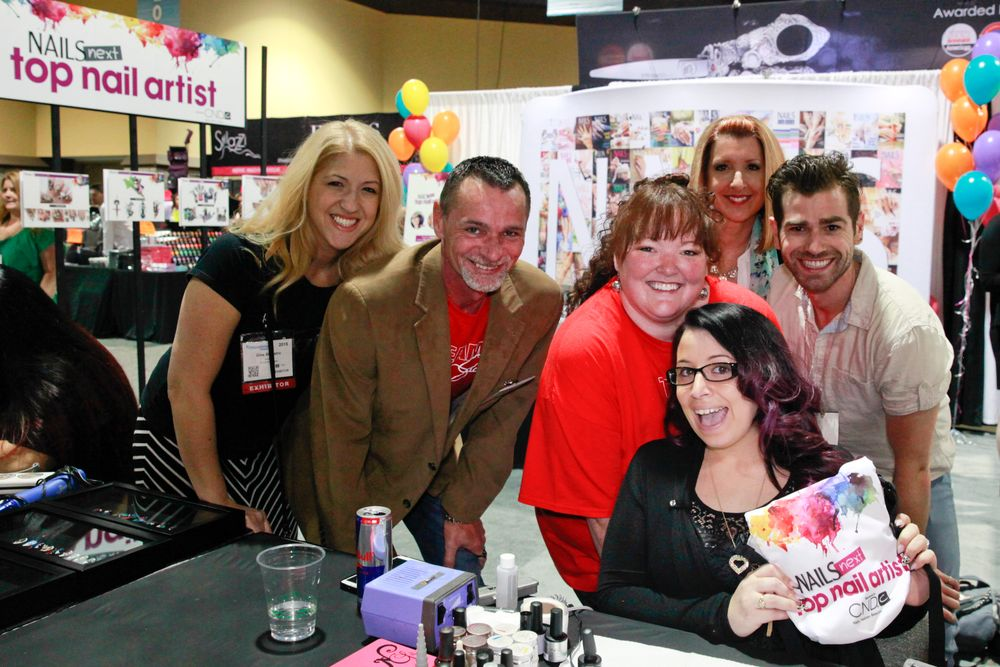 "<p>Gina Silvestro, Lucien Henderson, Holly Schippers, Vicki Smeerdyk, and Merrick Fisher (<a href=""http://instagram.com/merricures"">@merricures</a>) root on NAILS Next Top Nail Artist Top 3 contestant Danielle Costantino.</p>"